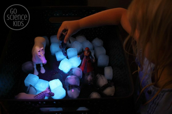 Glowing sensory play with fluorescent ice