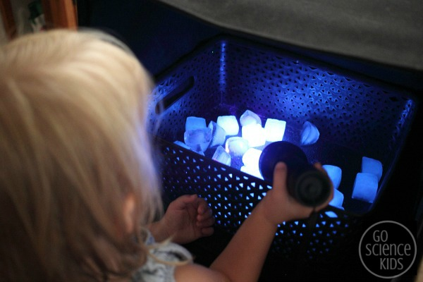 Science and sensory play with edible glowing ice