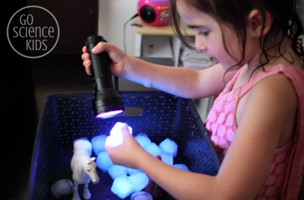 investigating glowing tonic ice cubes with a UV flashlight - fun science play for kids