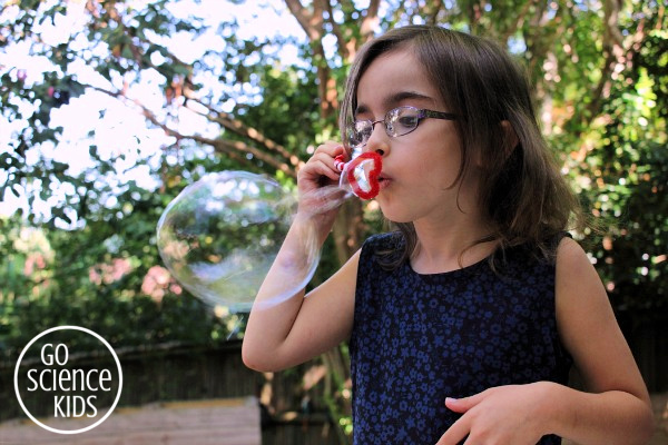 Blowing bubbles with the DIY heart bubble wand