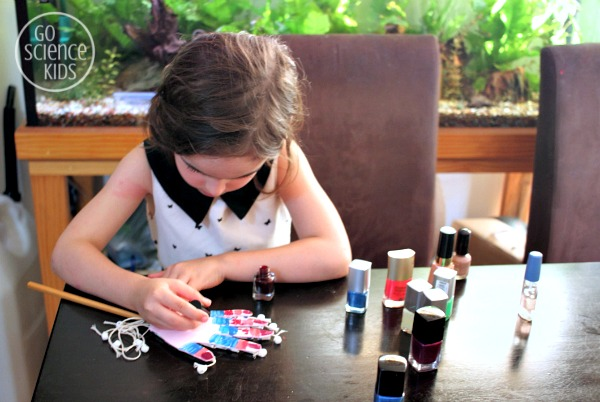 Jewel adding crazy nailpolish designs to her hand model