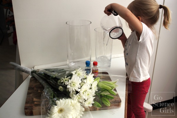 Pour water into the vases