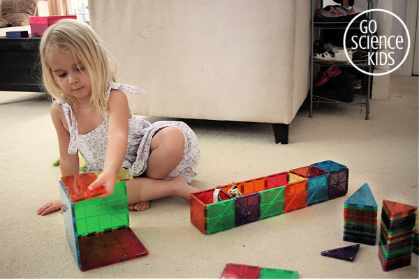 girl playing with magnatiles
