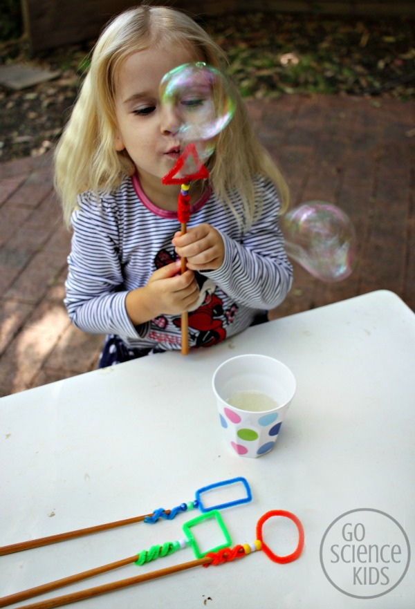 Blowing bubbles with the triangle shaped bubble wand