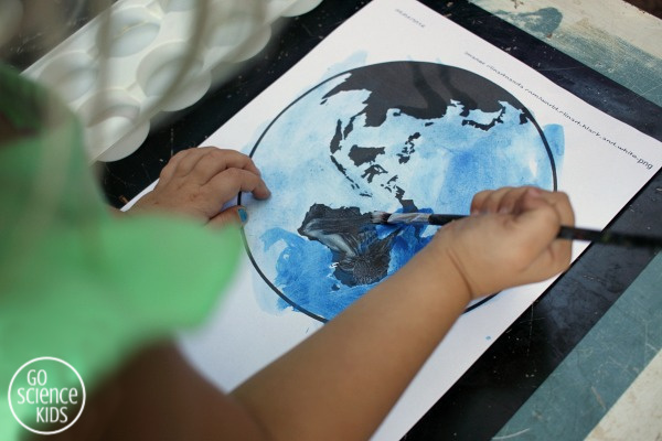 Planet earth craft for kids using real dirt to represent land. Fun craft for Earth Day