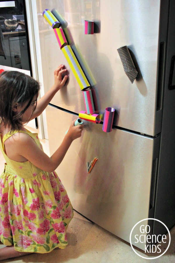 Make a DIY magnetic marble run for the fridge using toilet paper rolls and washi tape!